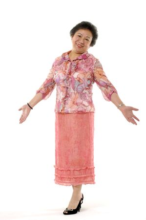 jovial: Senior asian woman shrug her shoulders. Isolated on white