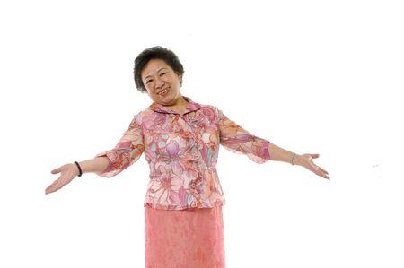 Senior asian woman shrug her shoulders. Isolated on white