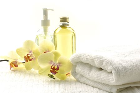 Spa essentials (white towel and yellower orchids)