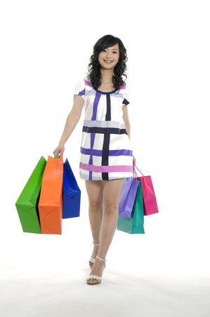 Beautiful woman with her bags happy shopping photo