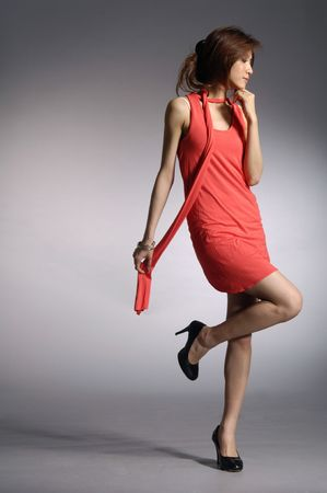 model posed on light background in nice dress Stock Photo