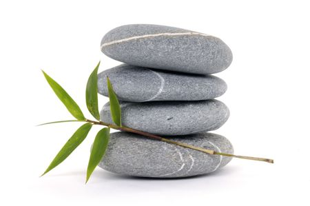 spiritual growth: Stacked pebbles bamboo leaf