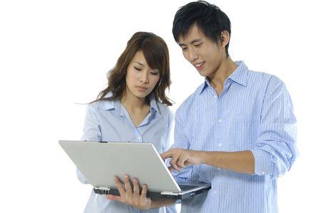 Couple using laptop photo