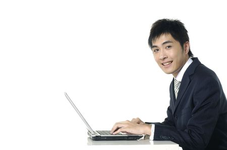businessman working with his laptop at his desk