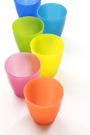 throwaway: Plastic cups of various colours isolated on white