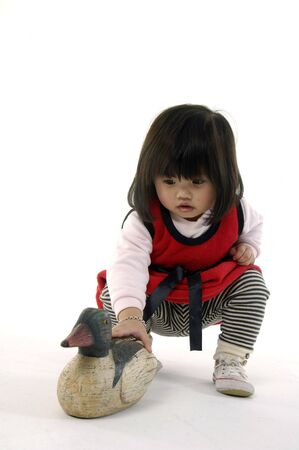 Small girl with animal toys photo