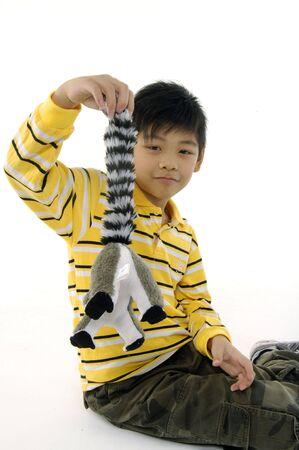 Asian kid with lemur toy photo