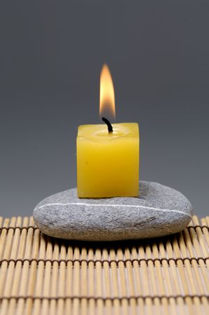 alight: alight candles and zen stone on mat