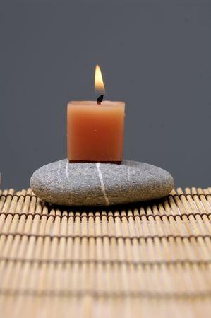 alight: aluce candele e zen stone on mat