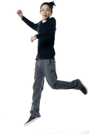 full shot: Young man jumping on white Stock Photo