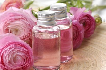 Perfume bottles with flower rose Stock Photo