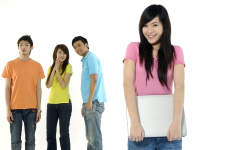 Asian group of happy friends –focus on girl holding a laptop computer  photo