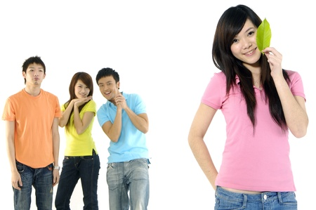 Asian group of happy friends –focus on girl holding leaf