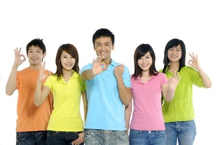 Asian friends group gesturing ok