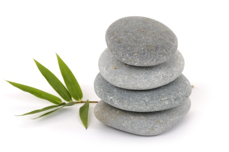 Stacked zen stones with bamboo leaf photo