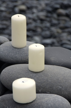Candle on zen stones simple relaxation photo