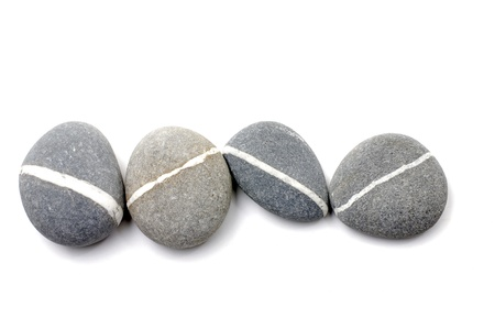 Four nature striped stones on white background