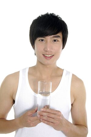 Asian Young happy smiling man with water glass