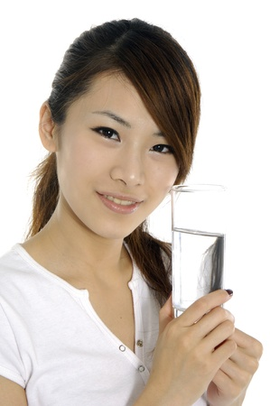 ice water: young woman with a glass of water Stock Photo