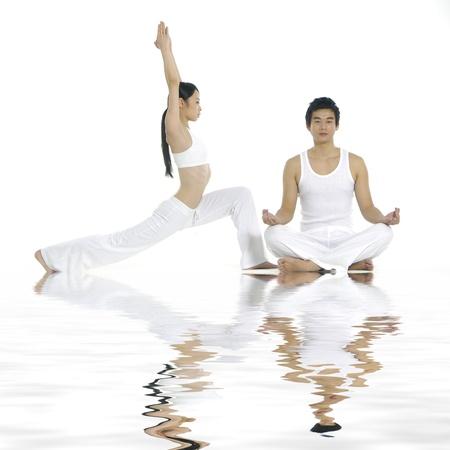 Reflection of couple doing yoga exercises together photo