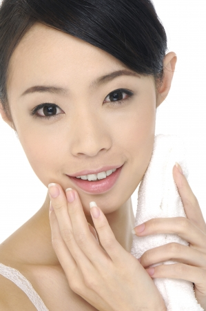 woman holding towel with health skin of face Stock Photo