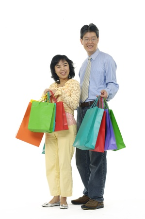 Shopping smile couple. on white background photo