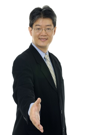 Businessman saying welcome Stock Photo