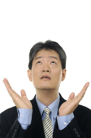 Stock photo of a surprised businessman looking up photo