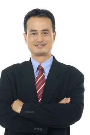 Business man with arms crossed against isolated white Stock Photo