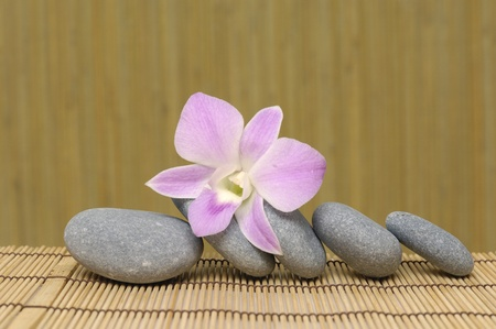 pyramid of stones with purple orchids, Spa essentials photo