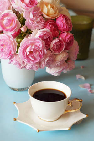 morning coffee on the table and pink roses, many flowers, beautiful flowers, background