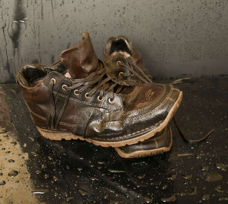 impregnated: leather shoes, drenched in water, close-up
