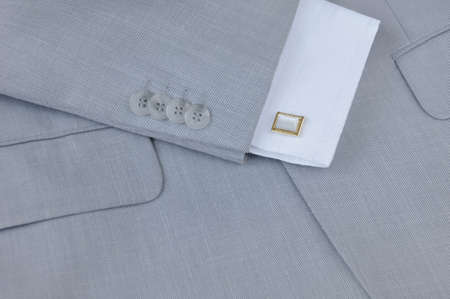 suit  cuff: Fragment of mens suit with cuffs and cuff links, close-up