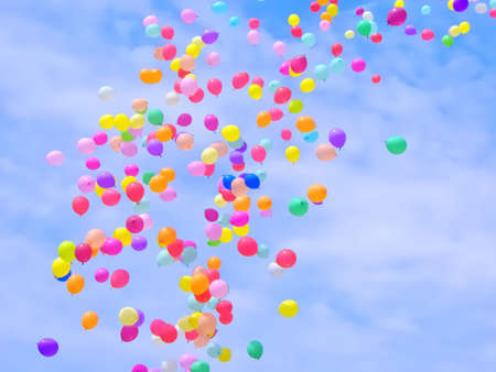 graduation party: A lot of colorful balloons flying in the sky Stock Photo