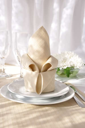 Coordinated decorative napkin on a plate with cutlery photo