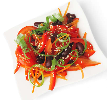 A salad of tomatoes, sweet peppers, red beans, carrots with sesame Standard-Bild