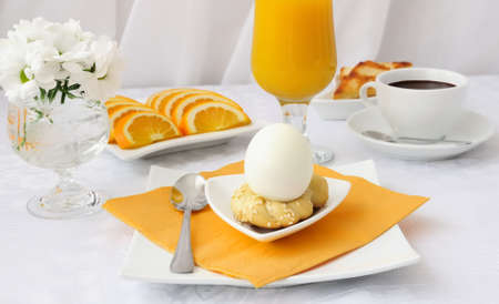 Breakfast with egg on sdobnoy stand with hot chocolate and orange juice photo