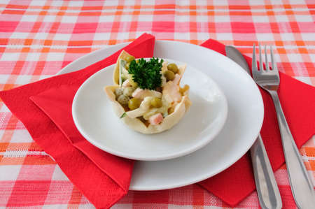 Cucumber salad, eggs, ham, peas, mayonnaise into tartlet (basket) photo