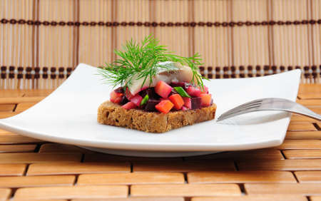 Sandwiches with rye bread, herring and vegetables Stock Photo - 9214575