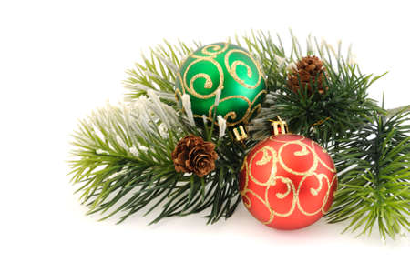 adjusted: Christmas balls against the backdrop of tinsel with pine branches and cones