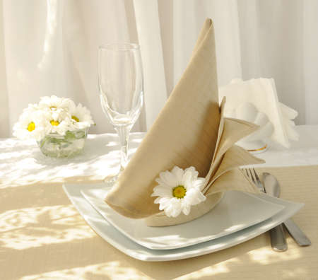 Coordinated decorative napkin on a plate with cutlery