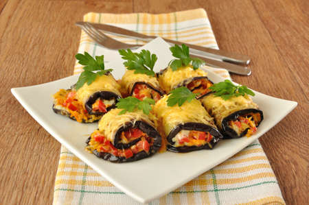 Stuffed eggplant with tomatoes, carrots and cheese Standard-Bild