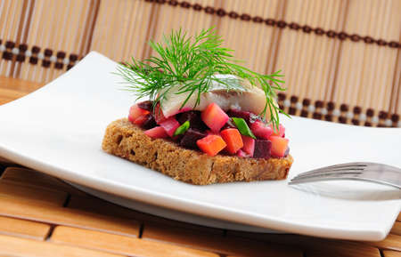 Sandwiches with rye bread, herring and vegetables Stock Photo - 10769208