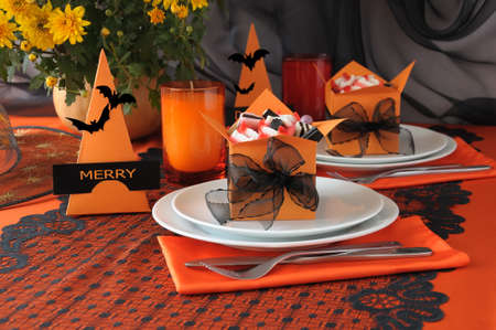 Festive table decoration for Halloween with candy in a box photo