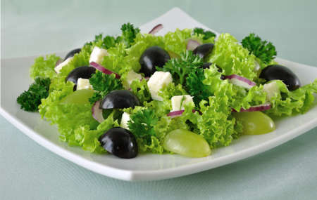 Salad of lettuce with cheese and grapes of different varieties