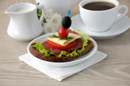 milkman: Salami sandwich and a cup of coffee with milk in the milkman Stock Photo