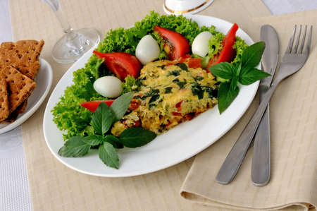 Omelete with zucchini vegetables with basil and lettuce photo