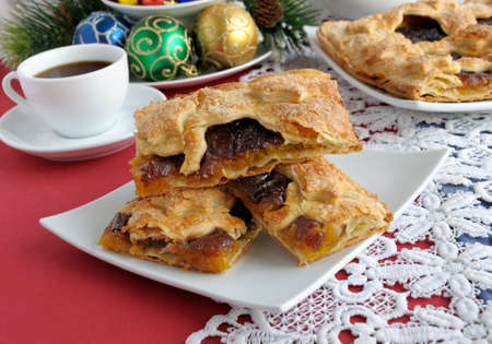 Pieces of strudel stuffed with apples and jam photo