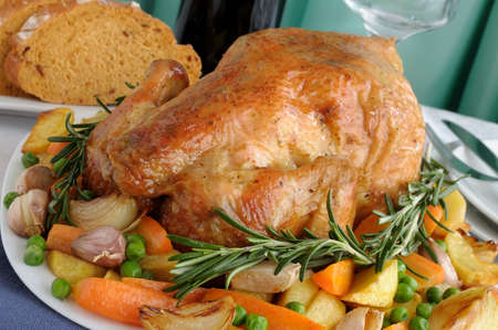 baked chicken: Baked chicken with vegetables and whole rosemary