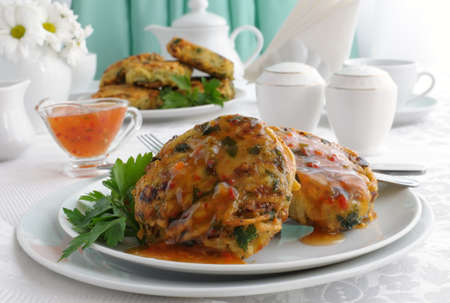 Potato pancakes with vegetables, sauce on the plate